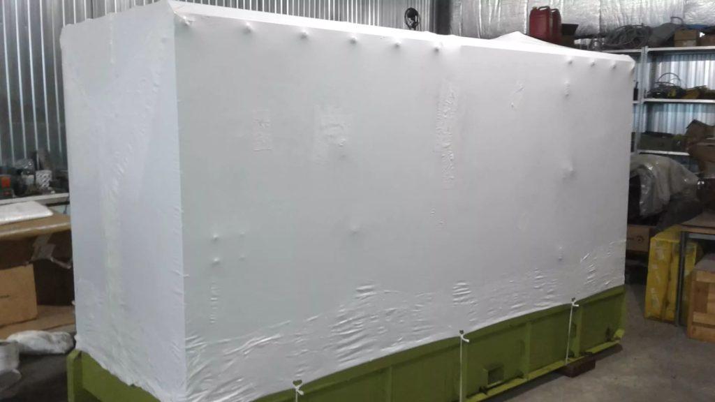 Упаковка демонтированных промышленных станков в пленку