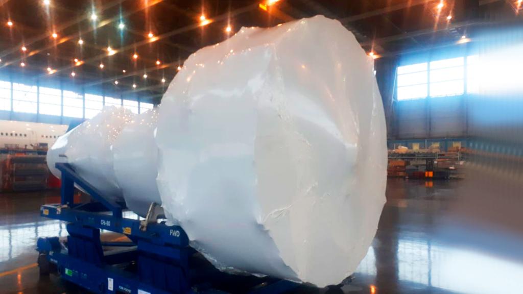 Упаковка объемных грузов в промышленную термоусадочную пленку Фастпэк. Услуги упаковки и поставка материала.